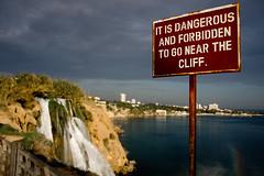 Dangerous and Forbidden (Melissa Maples) Tags: blue sea water sign clouds turkey waterfall rainbow nikon rust asia mediterranean trkiye antalya nikkor vr afs  18200mm   f3556g d40  18200mmf3556g  lowerdden