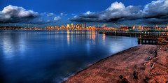 Seattle Skyline Reflected on Puget Sound (Surrealize) Tags: seattle city cloud reflection beach water skyline night buildings bay pier washington dock nikon dusk logs surreal calm pugetsound hdr placid elliotbay d700 surrealize