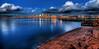 Seattle Skyline Reflected on Puget Sound (Surrealize) Tags: seattle city cloud reflection beach water skyline night buildings bay pier washington dock nikon dusk logs surreal calm pugetsound hdr placid elliotbay d700 surrealize