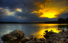 what is there (davedehetre) Tags: blue sunset orange sun lake color water clouds canon landscape rocks god shoreline fluffy shore kansas ripples rays hdr perfectsunsetssunrisesandskys therebeastormabrewin flickraward t1i cloudsstormssunsetssunrises