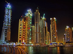 Marina nights (maistora) Tags: longexposure light blur color colour detail reflection building tower water skyline architecture night skyscraper marina buildings dark lights boat construction neon dubai cityscape darkness availablelight infinity uae emirates arab winner backgrounds getty duel alpha reflexions twisted unitedarabemirates topaz spotlights mariott adjust denoise maistora porjectors