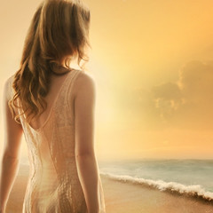 The voice inside (ilina s) Tags: ocean sunset sea woman beach yellow back wave curly pensive wistful lookingaway
