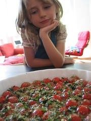 Marta checking the tomatoes