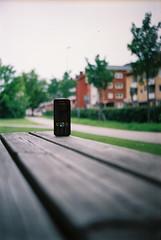 My phone (plastAnka) Tags: film crimson 35mm lomo bokeh sonyericsson creativecommons t43 cmeha lomosmena8m fujifilmsuperia100 135film 40mmf4 w890i