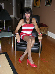 Ultra-Femme Transgender Lady in a Short Skirt and Sexy Pantyhose