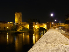 Ponte Scaligero (Marcot77) Tags: longexposure italy night reflections lights interestingness italia raw bynight verona luci lamps notturna notte lampioni italians pontescaligero 10faves explored 32s p1f1 superaplus aplusphoto holidaysvacanzeurlaub superhearts fz8 walkingcouple