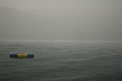 Storm on Open Water (symbot) Tags: ocean new york cloud lake ny storm rain day cottage upstate raft independence intimate downpour skaneateles