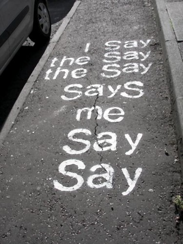 stencil graffiti that reads: I say / the say/ the say/ says/ me/say/say