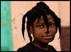Yeah, her hair rocks (LindsayStark) Tags: travel portrait girl haiti war conflict humanrights humanitarian humanitarianaid emergencyrelief waraffected