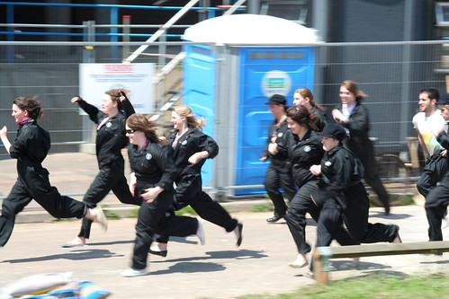 Scary people in black boiler suits.