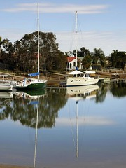 Platypus Reflections (Peppergroyne) Tags: autostitch water reflections boats brisbane scarborough yachts redcliffe platypus moonshine canonef70200mmf4l supershot canoneos30d baysidebrisbane superbmasterpiece canalestate sailcraft