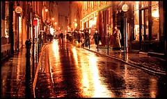 Rain on a City Street (SaundraG) Tags: street city paris reflection rain canon raining 2007 top20streetphotography top20paris saundrag
