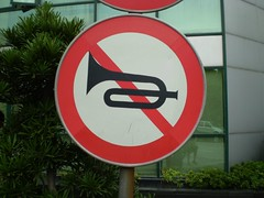 No trumpet playing! (actually this means no honking)