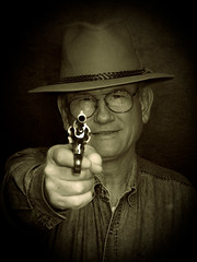 Go ahead, make my day.... - Your Best/Favorite Shot Ever (JGo9) Tags: man canon cowboy gun dad powershot western shooter sephia speedlight portriate supershot theunforgettablepictures s51s 430exii