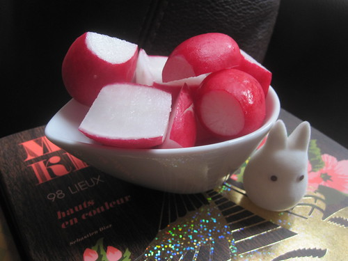 Radishes with small white Totoro friend