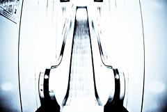The escalator (manganite) Tags: blue motion colors monochrome digital speed buildings germany underground subway geotagged moving high nikon key europe bonn metro tl empty escalator symmetric d200 subwaystation minimalism nikkor dslr toned selenium northrhinewestphalia 10faves 18200mmf3556 monochromia utatafeature manganite nikonstunninggallery date:year=2007 geo:lat=50722321 geo:lon=7155165 date:month=march date:day=11
