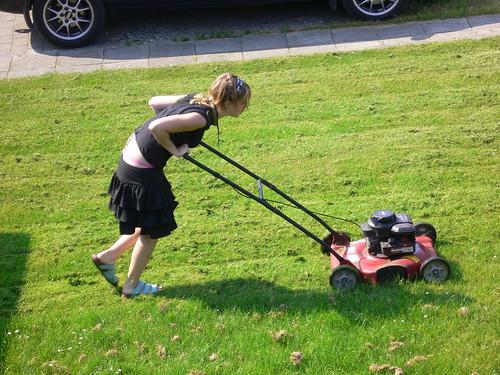 Bodil mows the lawn