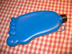 Foot-shaped hot water bottle with toenails