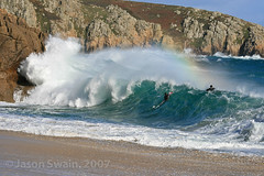 Shorebreak rainbow with bodyboarders at Porthcurno beach, Cornwall, UK (s0ulsurfing) Tags: ocean uk travel blue light sea vacation engl