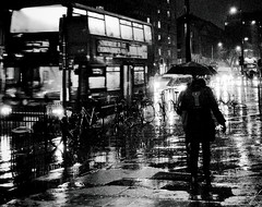 Man against the elements (Ian Brumpton) Tags: street uk england people urban blackandwhite bw storm black london blancoynegro rain silhouette night umbrella shower blackwhite noir noiretblanc unitedkingdom britain pavement candid streetshots streetphotography streetportrait sidewalk rainy monsoon rainstorm doubledecker downpour londonbus londonist streetphotographer blackwhitephotos stryker66