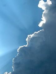 Calgary sky before a hail storm (LaurenMills) Tags: blue light sky cloud sun calgary up hail heaven ray spirit explosion alberta sunburst thunderstorm burst beforethestorm sunbeam explode rolling sunray calmbeforestorm