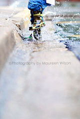 Jump (maureenwilson) Tags: boy feet water rain kids jump shoes downtown dof boots tanner gutter splash 2yearold 85mmf18 naturallightkids mykiddos nikond80 weeklynofacesarchival