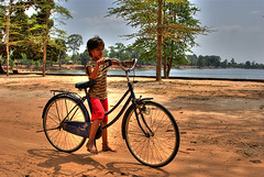 Big Bike, Little Boy (Nocternal Oxide) Tags: boy bike big little small hdrcambodiaangkorwatsiemreap