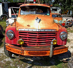 Studebaker tow truck (Texas Finn) Tags: old light red orange color reflection classic abandoned glass car truck vintage mirror rust colorful texas rusty tire explore bumper rusted parked headlight grille windshield weatherford blueribbonwinner shieldofexcellence