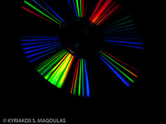 Rays of Color (KSM Digital Photography) Tags: blue light red lightpainting abstract black color reflection green texture industry colors yellow digital computer circle design pc dvd code rainbow keyboard media key shiny ray pattern technology spectrum bright image symbol cd laptop text internet experiment optical science storage line communication equipment help reflect disk electronics software button record backgrounds physics data binary push network rays enter press disc information audio typing global raysoflight optics luminosity greenblue bytes