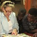 Shelly Campbell reads with children at the Fountain of Hope Lubuto Library