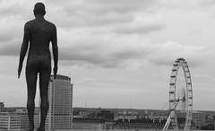 Gormley Statue & London Eye (anniemullinsuk) Tags: london londoneye gormleystatue