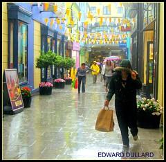 """RUN FOR COVER"" (Edward Dullard Photography. Kilkenny, Ireland.) Tags: kilkenny ireland urban irish wet rain weather umbrella shopping erin oneofakind photographic eire explore hibernia emeraldisle irlanda irlande ierland eireann dullard cillchainnigh beautifulireland platinumphoto discoverireland rlueribbonwinner onlythebestare kilkenny1953 excapture societyedward"