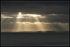Sunrays 2 (Roger.C) Tags: ocean light sunset sea sun lighthouse water beautiful canon island tide rays beams channel weston 30d flatholme