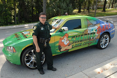 Coolest Cop Car Ever (Paul McRae (Delta Niner)) Tags: street hot ford sunglasses leather pose cool uniform gun florida awesome hey lion fast police explore badge cop fl dare sheriff mustang artcar officer lakecounty dodgecharger interceptor magwheels 10faves explored d800fr