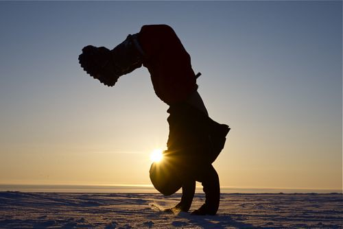 Arctic acrobat. Backflip, midnight sun, up near the magnetic North Pole