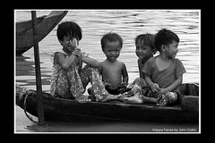 Happy faces (Heaven`s Gate (John)) Tags: vacation lake water children boat top20bw cambodia siemreap tonlesap floatingvillage happyfaces blackwhitephotos johndalkin heavensgatejohn