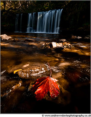 Downstream (andrewwdavies) Tags: longexposure autumn mist fall leaves wales cymru falls spray filter waterfalls lee swirls rays reds pontneddfechan circularpolariser canonefs1022mmf3545usm uchaf dappledlight autumnalcolours waterfallwalk canoneos7d andrewwilliamdavies pontmelinfach sgwdddwli leebigstopper