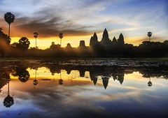 Sunrise Discovery of Angkor Wat (Stuck in Customs) Tags: world morning travel light sun reflection art beautiful architecture clouds sunrise religious temple photography photo nikon ruins colorful asia cambodia pretty vishnu khmer dynamic buddha buddhist gorgeous south religion d2x dream monk buddhism angkorwat fresh divine professional adventure international photograph stunning charming vat reverence foreign fabulous siemreap angkor wat hindu discovery technique archeology hdr tutorial trey artisitic angkorvat engaging travelphotography ratcliff theravada quincunx suryavarman d2xs hdrtutorial stuckincustoms imagekind treyratcliff theravadabuddhist focuspocus2 nokor pisnulok jagati dopplr:explore=a081