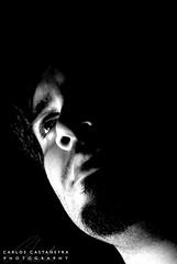 Blurry Future (Xtreme Charlie) Tags: portrait bw face closeup blackwhite blurry eyes shadows looking puertorico retrato cara charlie ojos half mirada ricky sombras sonyalpha carloscastaeyra ricardocastaeyra