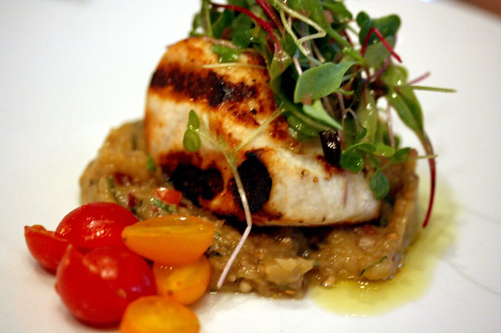 Swordfish with eggplant caviar and teardrop tomato salad