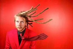 blown away (Perpetually) Tags: red suit dreads mads dreadhead blownaway