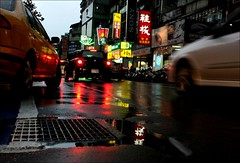 rainy day 04 (hey-gem) Tags: road street city people urban reflection cars wet water rain reflections lights slick rainyday traffic cab taxi taiwan taxis vehicles rainy transportation pedestrians scooters taipei cabs taxicabs taipeicity pedestrianlane misadventuresintaiwan