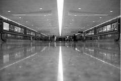 End of the Road (shutterBRI) Tags: trip travel bw usa ny newyork reflection monochrome canon reflections photography mirror photo vanishingpoint airport perspective terminal symmetry powershot jfk american symmetric symmetrical mirrorimage americanairlines 2007 airtravel jfkairport nonluoghi a630 terminal9 nonplace shutterbri nonlieux brianutesch photofaceoffwinner pfogold brianuteschphotography
