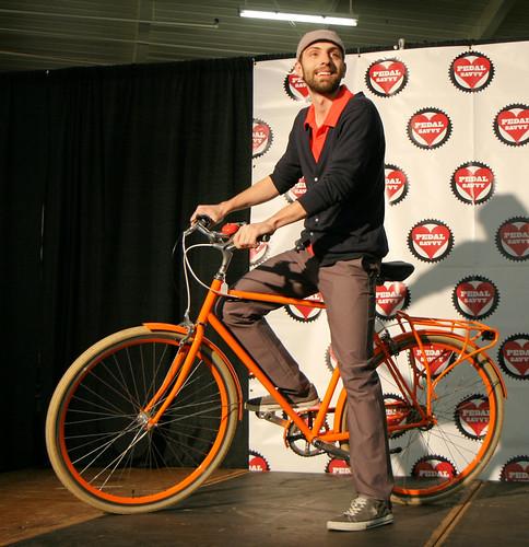 Orange shirt, orange bike