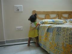 Exploring the corner of the bed.jpg (S Jagadish) Tags: bangalore amma satish appa thatha paati jaagruthi 200505 royalpalms janu jagadish krithi santhanam chitappa