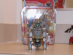 Grimlock, G1, posing with Classics Grimlock, still in his box.