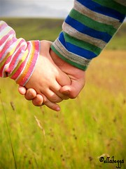 Friends (Erla Berglind) Tags: friends boy green girl grass yellow children iceland hands friendship searchthebest finger straw handshake lead striped protect stripy doublebeauty isawyoufirst ellabegga takebythehand
