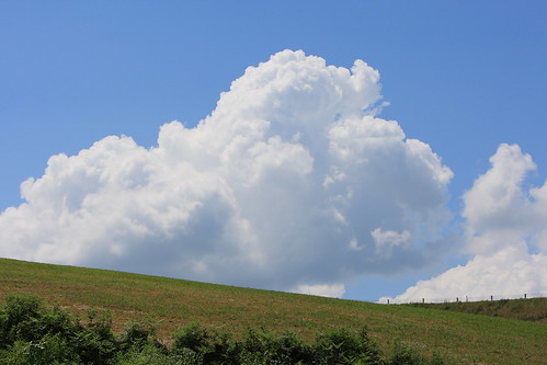 Summer clouds on the hill