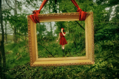 Framed in Fairytale (.Bradi.) Tags: trees red selfportrait green overgrown girl forest woods dress growth littleredridinghood f pictureframe lostinthewoods fisforframe