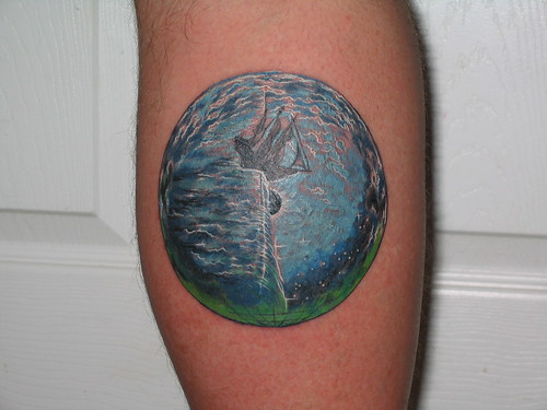 An earth tattoo depicting an old sailing ship as